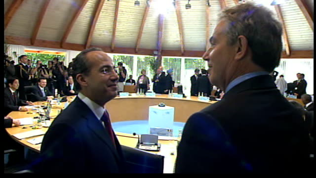 Africa aid pledge criticised INT Blair chatting and laughing with Sarkozy Blair shaking hands and making smalltalk with Felipe Calderon SOT Merkel on...