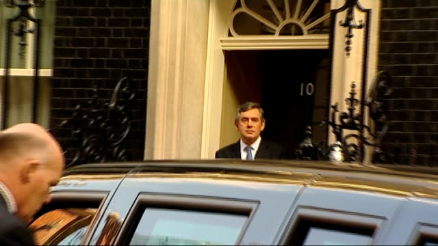 barack obama leaves downing street england london downing street ext gordon brown mp and barack obama cross road and into number 10 together / barack... - ゴードン ブラウン点の映像素材/bロール
