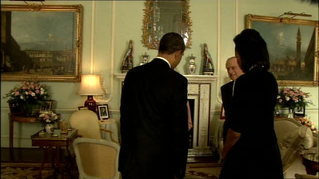 Barack Obama meets Queen Elizabeth ENGLAND London Buckingham Palace INT Barack Obama and Michelle Obama enter room and handshake with Queen Elizabeth...