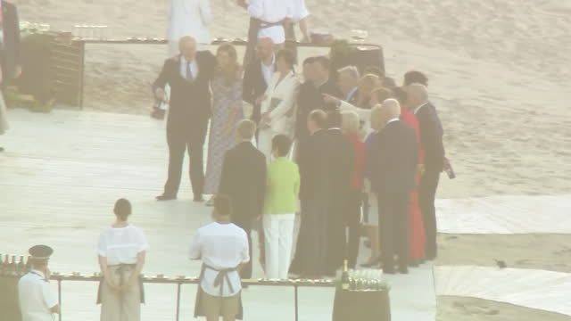 summit beach bbq for leaders and families, includes boris johnson and emmanuel macron talking and group photo - husband stock videos & royalty-free footage