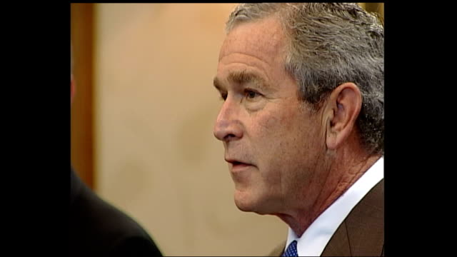 blair and bush pre meeting discussion; scotland: gleneagles: int george w bush speaking to press sot q&a zoom in to andrew marr asking question... - perthshire stock videos & royalty-free footage
