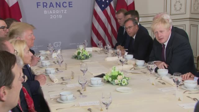 boris johnson and donald trump breakfast meeting france biarritz boris johnson speaking sot congratulations on everything the american economy is... - g7サミット点の映像素材/bロール
