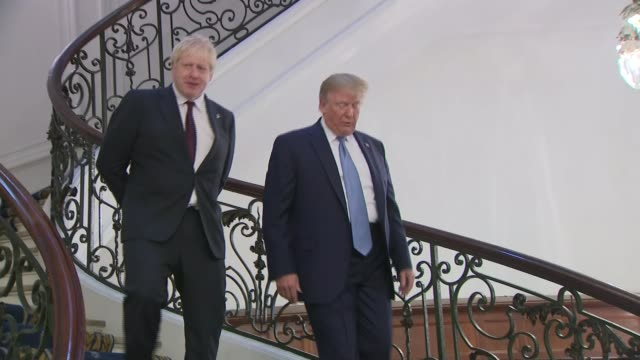 boris johnson frustrated in talks with donald tusk france biarritz g7 summit int boris johnson mp and donald trump down staircase together ahead of... - boris johnson stock videos and b-roll footage