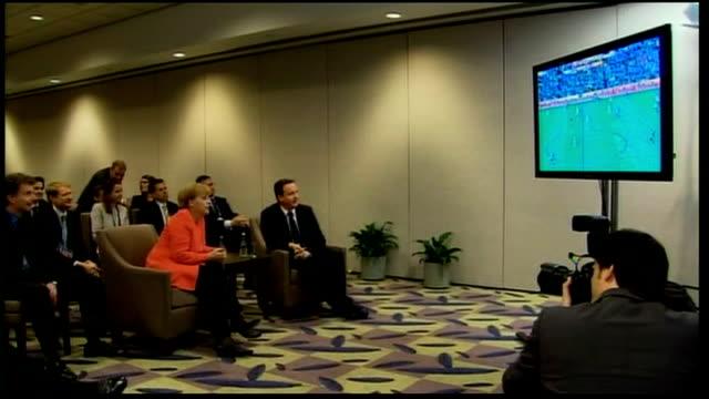 Budget deficit talks / leaders watch World Cup CANADA Toronto INT David Cameron MP and Angela Merkel watching EnglandGerman World Cup football match...