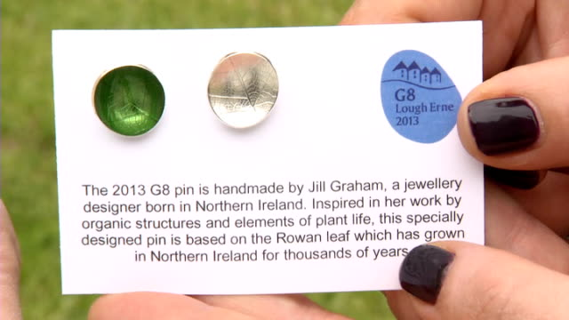 cameron presneted with g8 pin northern ireland enniskillen ext card holding commemorative g8 summit pins held by jewellery designer jill graham lough... - g8 summit stock videos & royalty-free footage