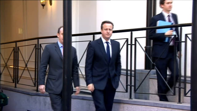 stockvideo's en b-roll-footage met eu summit considers possible sanctions against russia *** warning prime minister david cameron mp out of building to speak to press - mogelijk