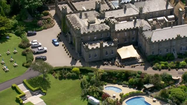 cornwall aerials; england: cornwall: ext air view shots of carbis bay / aerials of tregenna castle resort . - tourist resort stock videos & royalty-free footage