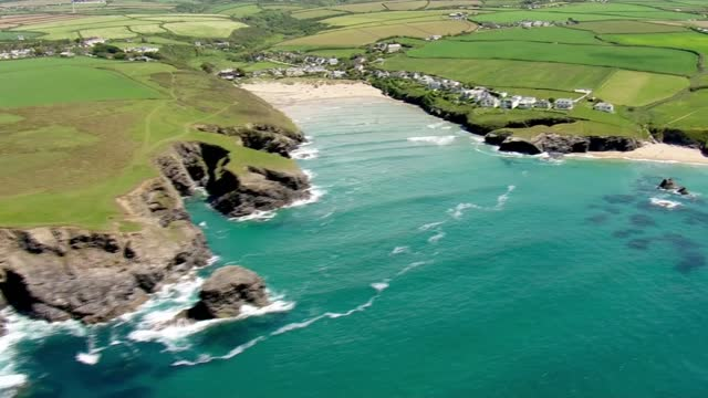 cornwall aerials; england: cornwall: ext air view shots of coastline with rocks, cliffs, coves, beaches, fields, coastal path and lighthouse /... - bay of water stock videos & royalty-free footage