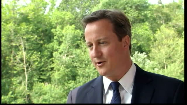 david cameron defends coalition government ext cameron interview sot theres an idea we might try and watch it together i'll try not to wrestle her to... - g8 stock-videos und b-roll-filmmaterial