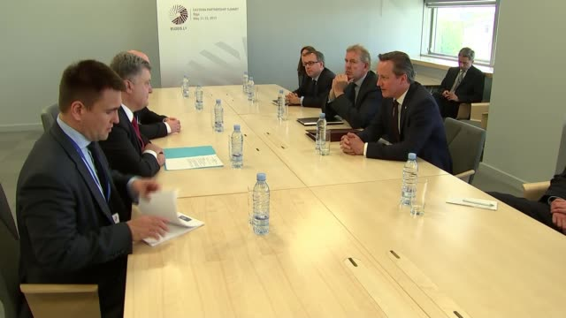 David Cameron meets Ukraine President Petro Poroshenko LATVIA Riga INT David Cameron MP at talks table with Petro Poroshenko and their delegates