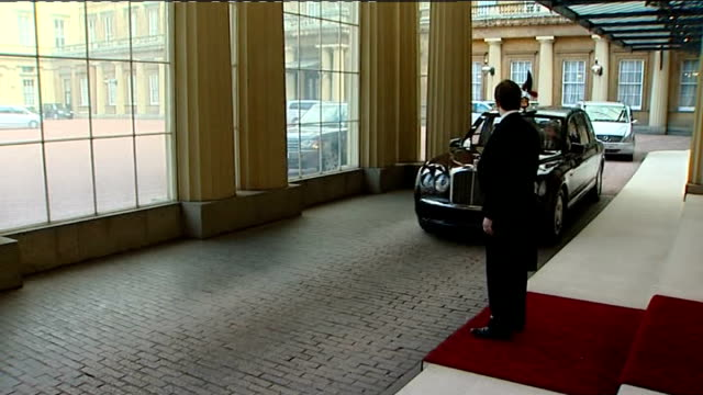 G20 dignitaries arriving at Buckingham Palace ENGLAND London Buckingham Palace EXT Limousine arriving at Buckingham Palace / Valet opening car door...