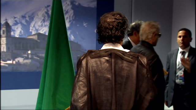 gordon brown meets colonel gaddafi; italy: l'aquila: int back view of colonel gaddafi as waits for gordon brown's arrival / gordon brown mp along to... - gordon brown stock videos & royalty-free footage