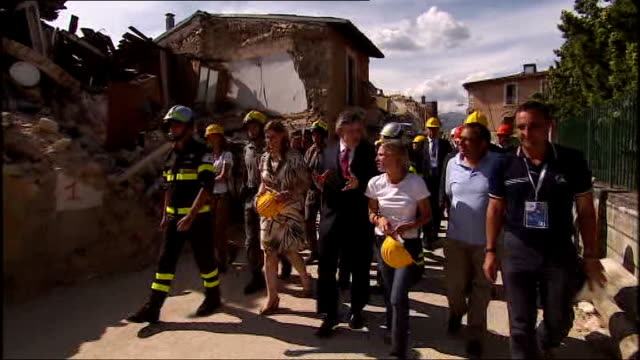 gordon brown tours areas destroyed by earthquake in l'aquila; italy: l'aquila: ext various shots of gordon brown mp and his wife sarah brown touring... - damaged stock videos & royalty-free footage