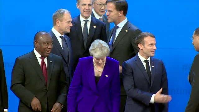 G20 Summit group family photo Theresa May stood inbetween South Africa's President Cyril Ramaphosa and French President Emmanuel Macron