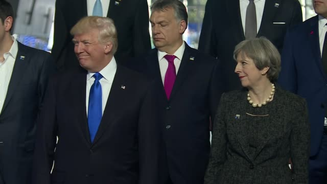 Group photocall BELGIUM Brussels INT NATO Summit group photocall family photograph Prime Minister Theresa May stands next to US President Donald...