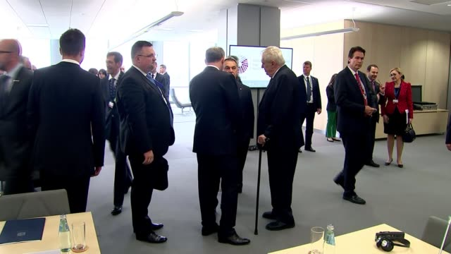David Cameron photocall and meeting LATVIA Riga INT Unidentified people into reception room and standing chatting/ David Cameron MP int oroom with...