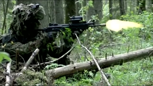 Leaders address Ukraine crisis and threat of Islamic State 2152014 / T21051412 ESTONIA British troops firing guns in forest area British soldiers...