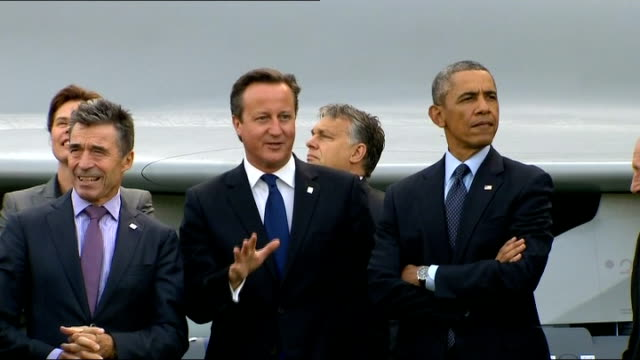 Leaders address Ukraine crisis and threat of Islamic State WALES Newport EXT NATO leaders gather for family photocall in front of British fighter...