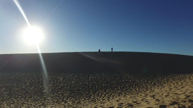 summit of the pyla dune, a summer morning. children and a woman walk in the sand atop the pyla dune - arcachon stock videos and b-roll footage
