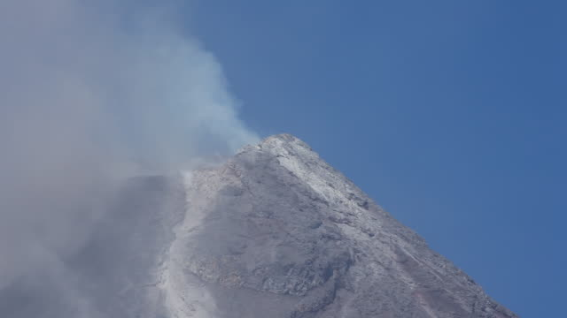 cu summit of volcano smoking, mayon, philippines, december 2009 - philippines stock videos & royalty-free footage