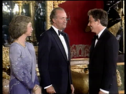 Summit POOL SPAIN Madrid MS Bill and Hillary Clinton in evening dress arriving for banquet CMS Tony Blair in evening dress shaking hands with King...