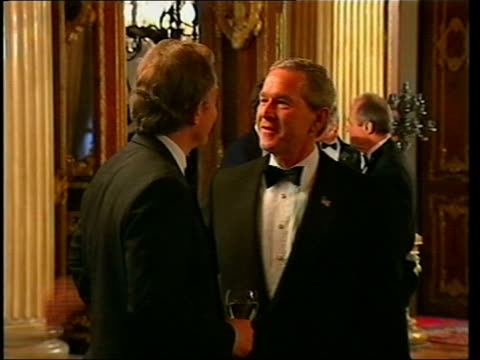 summit; pool turkey: istanbul: int lms us president george w.bush and prime minister tony blair mp standing chatting as bush puts arms on blair's... - us president stock videos & royalty-free footage