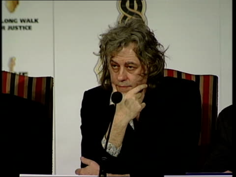 stockvideo's en b-roll-footage met g8 summit preparations / proposed poverty protest file / tx 31505 london sir bob geldof towards along corridor into press conference ms elton john... - bob geldof