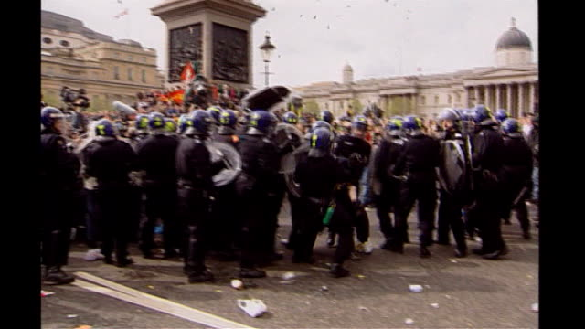 Prospects for global agreement TX ENGLAND London EXT Various of police officers clashing with protesters at May Day demonstration in 2000