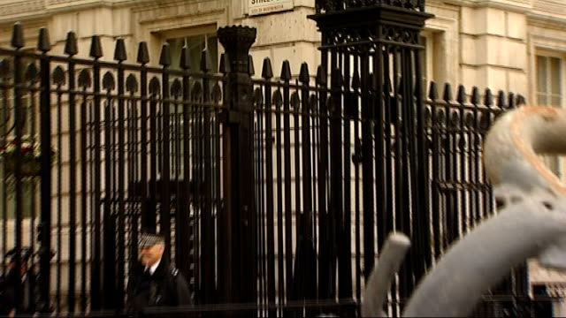 downing street security preparations; england: london: downing street: ext security barriers outside downing street / sign for downing street /... - enclosure stock videos & royalty-free footage