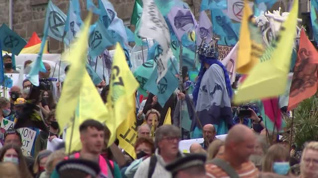 protesters lobby g7 leaders on 'climate emergency'; england: cornwall: st ives: carbis bay: ext **protesters singing overlaid sot** protester wearing... - war and conflict stock videos & royalty-free footage