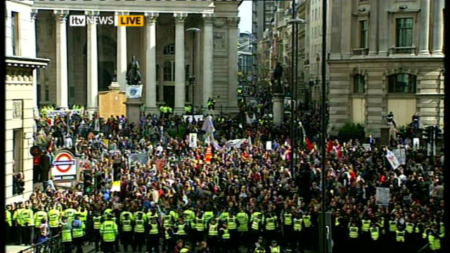 protests england london city crowd of g20 protesters flanked by lines of police officers - group of 20 stock videos & royalty-free footage