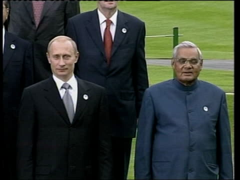 Protests POOL Bush chatting to Chirac as leaders gather for photo MS Russian President Vladimir Putin and Indian Prime Minister Atal Bihari Vajpayee...