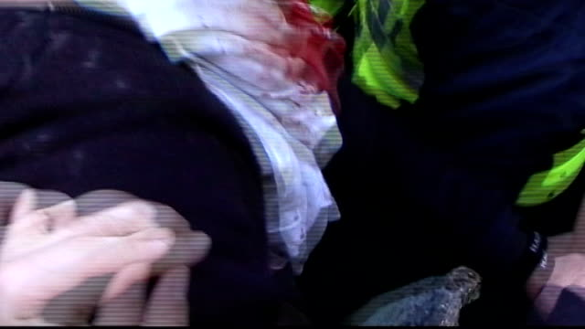 protests Protester with blood streaming down his face remonstrating with police officers SOT Protester falls as curls into foetal position SOT Line...