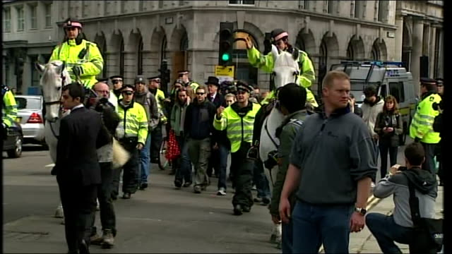 protests tribute to man killed england london ext small group of protesters along street escorted by police officers / protesters and escort standing... - moving after stock videos & royalty-free footage