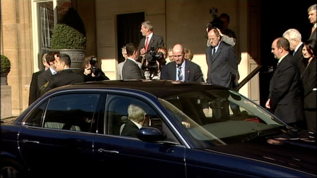 sarkozy - merkel press conference arrivals; england: london: ext nicolas sarkozy out of car and greeted on steps of building by german chancellor... - president of france stock videos & royalty-free footage