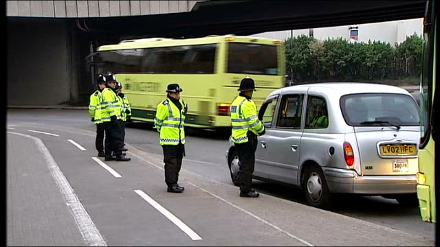 Security ENGLAND London Docklands EXT Police officers standing in coprdoned off street leading to the ExCel Centre where the G20 summit of world...