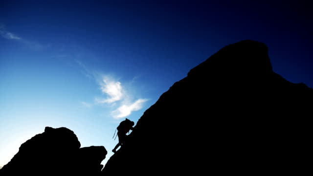 summit silhouette - rock climbing stock videos & royalty-free footage