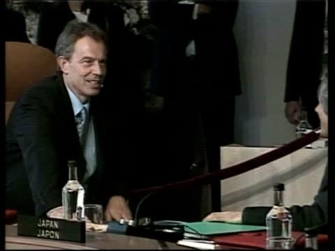 situation in africa; pool - no resale. canada: alberta: kananaskis: int us president george w bush at desk british prime minister tony blair mp pull... - 年次イベント点の映像素材/bロール