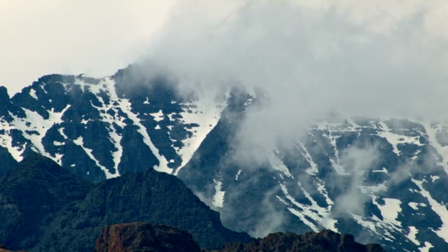 Summit snowy rocky cliffs and fog clouds Alvord Desert Steens Mountain Near Malhuer Wildlife Refuge 4