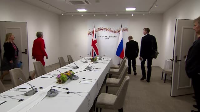 theresa may confronts vladimir putin over the poisoning of sergei skripal in salisbury japan osaka int theresa may mp arriving in room and shaking... - sergei skripal stock videos and b-roll footage