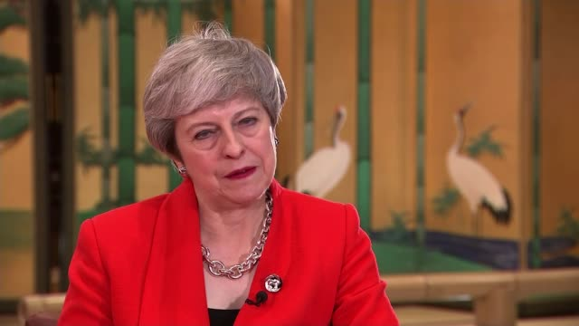 theresa may confronts vladimir putin over the poisoning of sergei skripal in salisbury japan osaka int theresa may mp arriving in room for interview... - theresa may stock videos & royalty-free footage