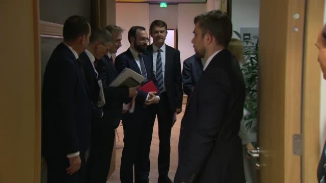 Theresa May meeting Donald Tusk BELGIUM Brussels INT Donald Tusk / Tusk along and shaking hands with Theresa May MP / Tusk and may with others at...