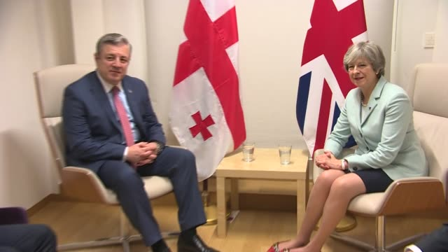 Theresa May meeting Georgian Prime Minister BELGIUM Brussels INT Theresa May MP chatting to Giorgi Kvirikashvili