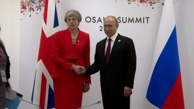theresa may photocall with vladimir putin japan osaka g20 summit int theresa may mp arriving in room and shaking hands handshake at photocall with... - photo call stock videos & royalty-free footage