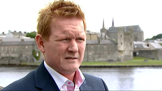 g8 summit to take place in enniskillen traffic along road past cenotaph stephen gault setup shot with reporter / interview sot rowing coach giving... - guglia video stock e b–roll
