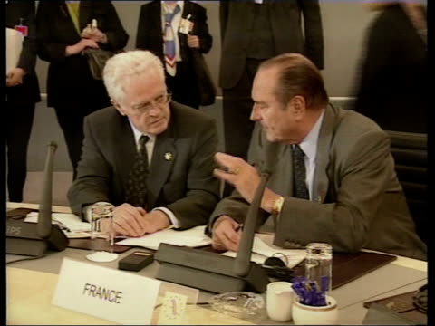 UK rebate Int CMS Gerhard Schroeder lighting cigar MS Jacques Chirac and Lionel Jospin seated Blair laughing with others and along PAN Schroeder...
