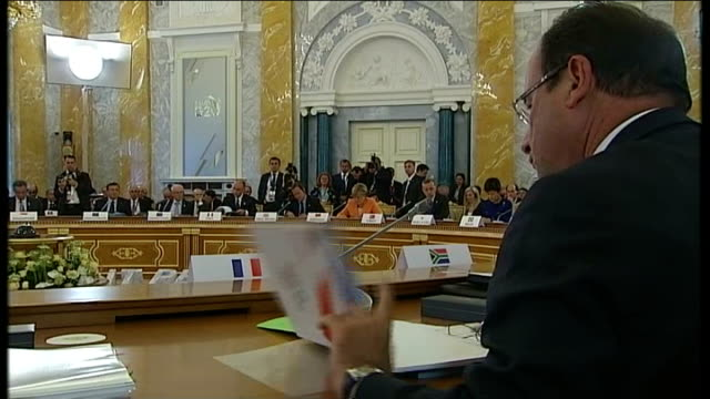 us president barack obama increasingly isolated over syria francois hollande with hand on chin obama at table with earpiece on back view hollande at... - chin stock videos and b-roll footage