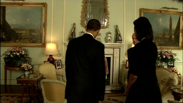 world leaders arrive in london england london buckingham palace int barack obama and his wife michelle obama enter room and handshake with queen... - g20 leaders' summit stock videos & royalty-free footage