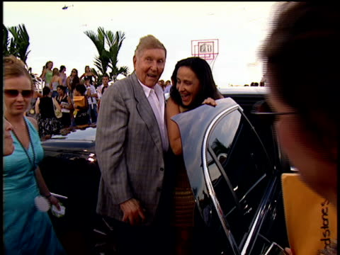 sumner redstone and paula fortunato getting out of their car and posing for pictures at the 2004 mtv mtv video music awards red carpet in miami - mughal empire stock videos and b-roll footage