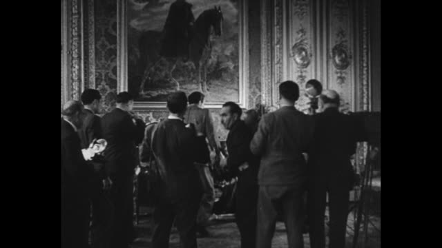sumner welles, us undersecretary of state, and wladyslaw sikorski, polish premier in exile, seated at table in ornate room; anthony j. drexel biddle,... - esilio video stock e b–roll